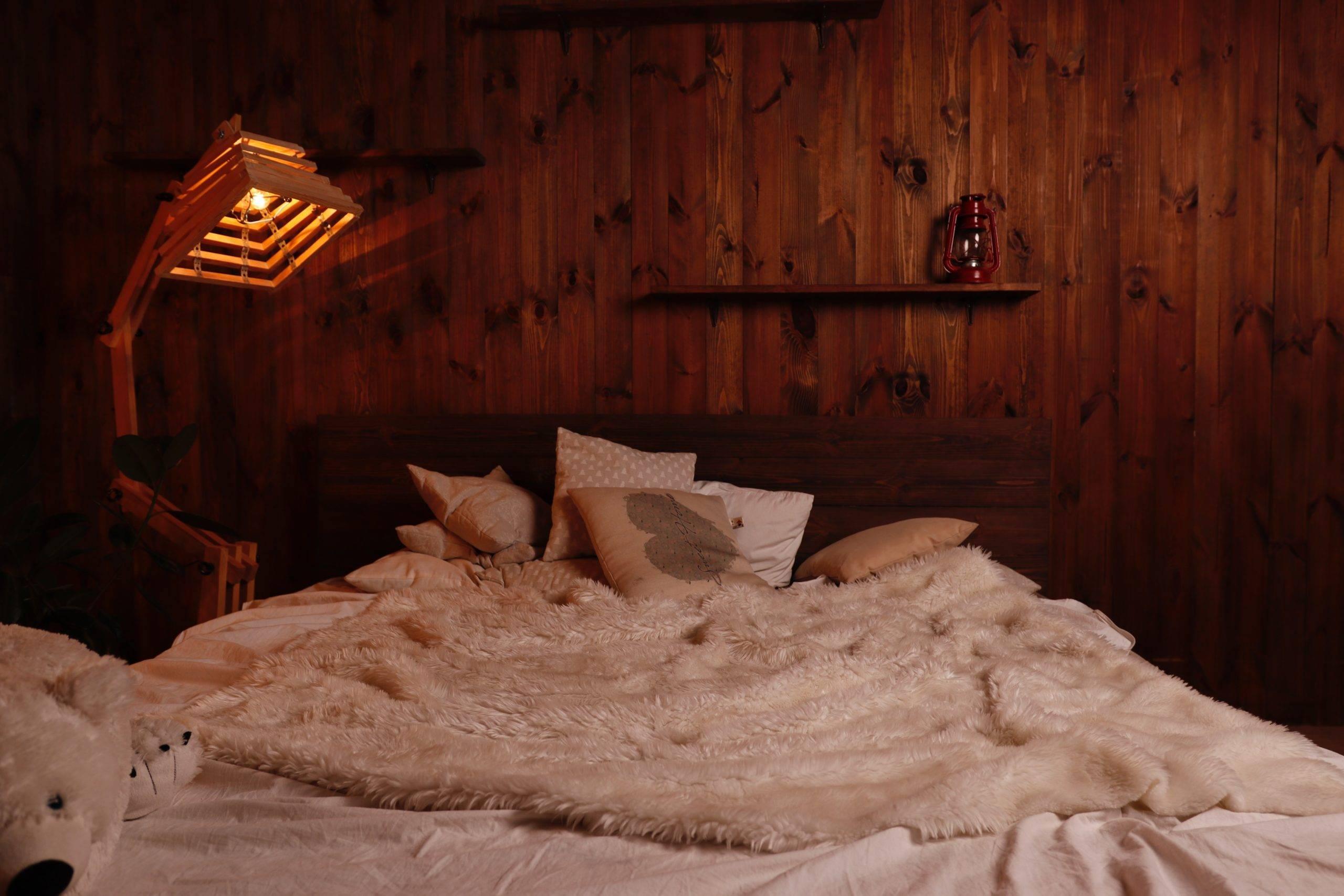 Unique lamp beside bed