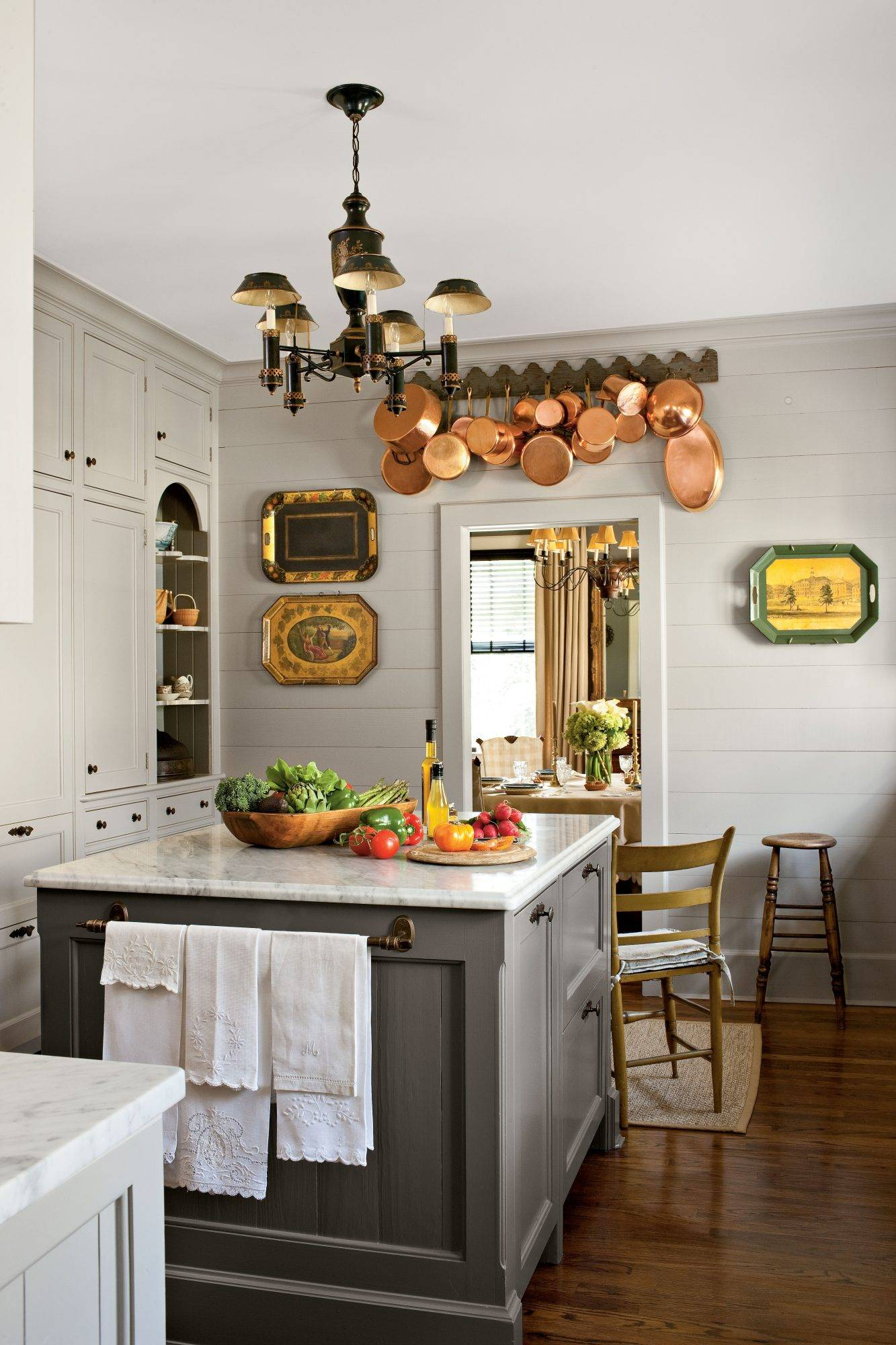 Vintage platters and cookware hanging on white wall
