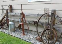 Vintage wheels, pump and jar on gravel