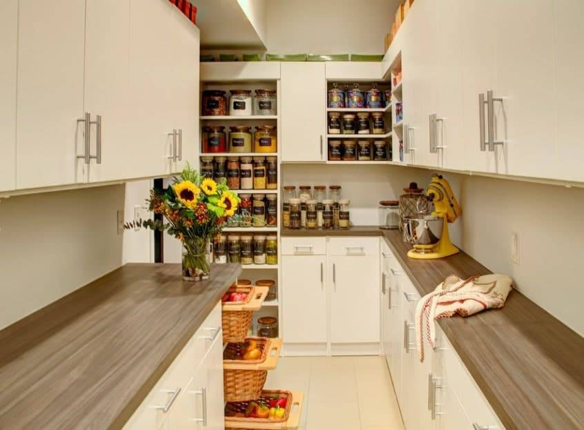 Walk-in pantry with cabinets and sliding drawers