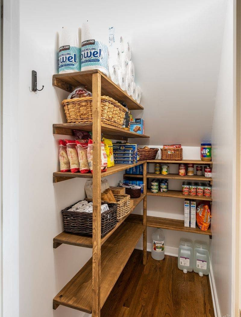 Walk-in pantry with wooden shelves