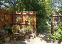 Walled garden with rattan baskets, hats and wicker chair