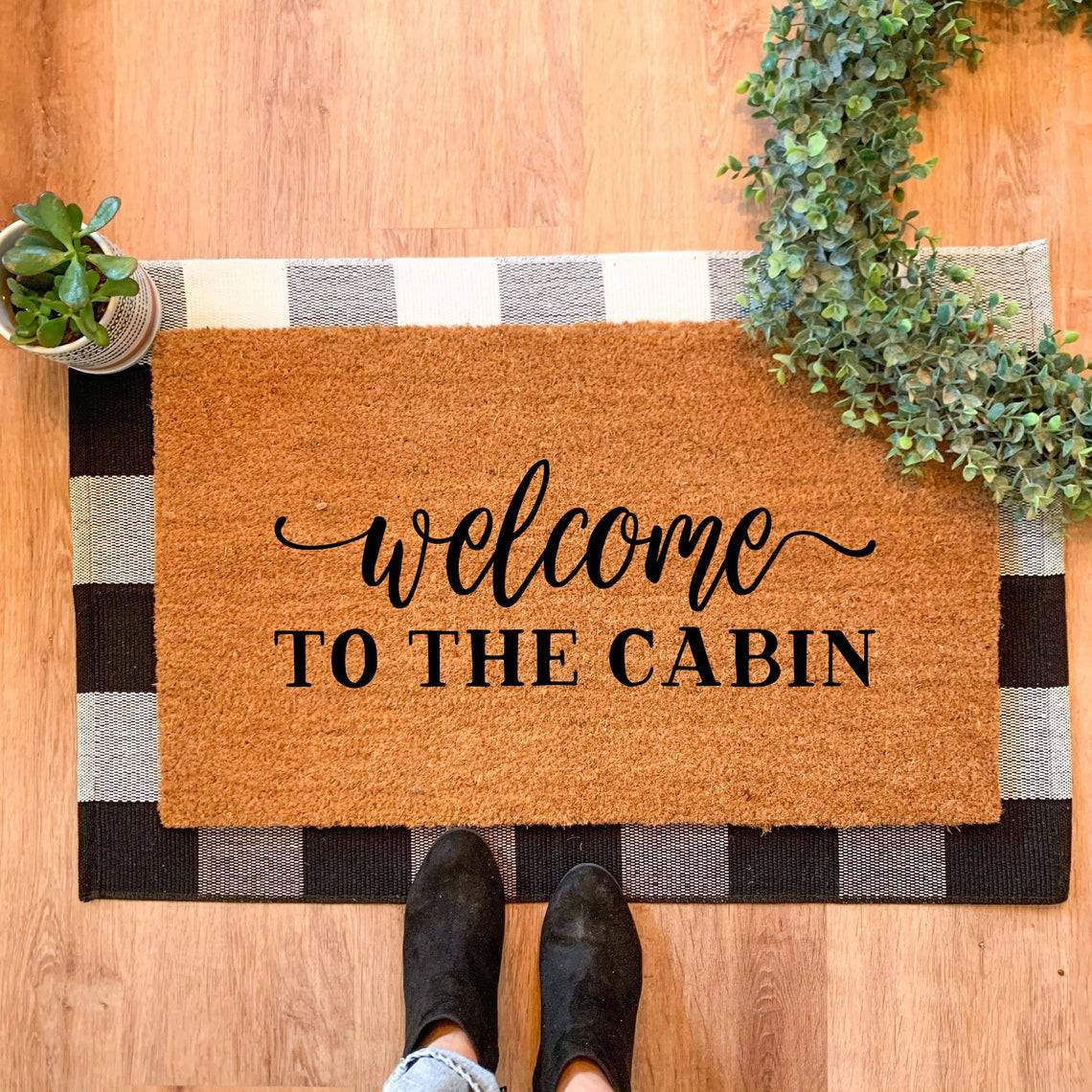 Welcome to the cabin rug on the floor
