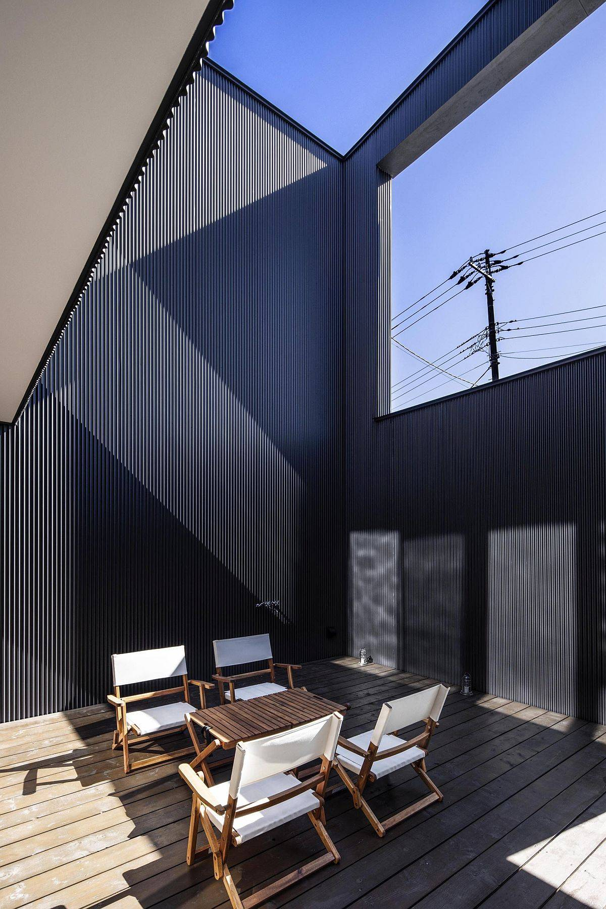Well-lit and stylish gray upper level deck of the Japanese home