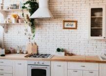 White bricks kitchen wall with range hood