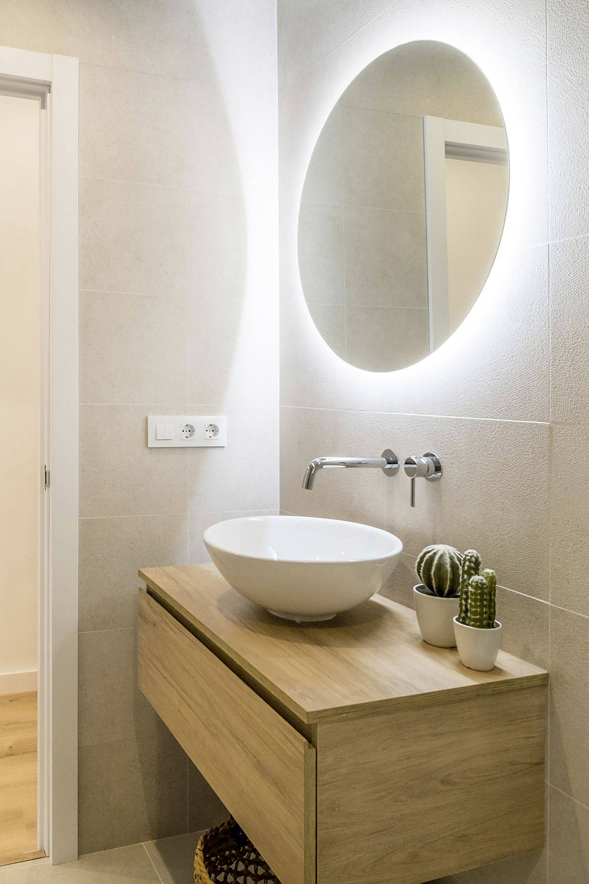 Wooden vanity in the corner for the small modern bathroom in white