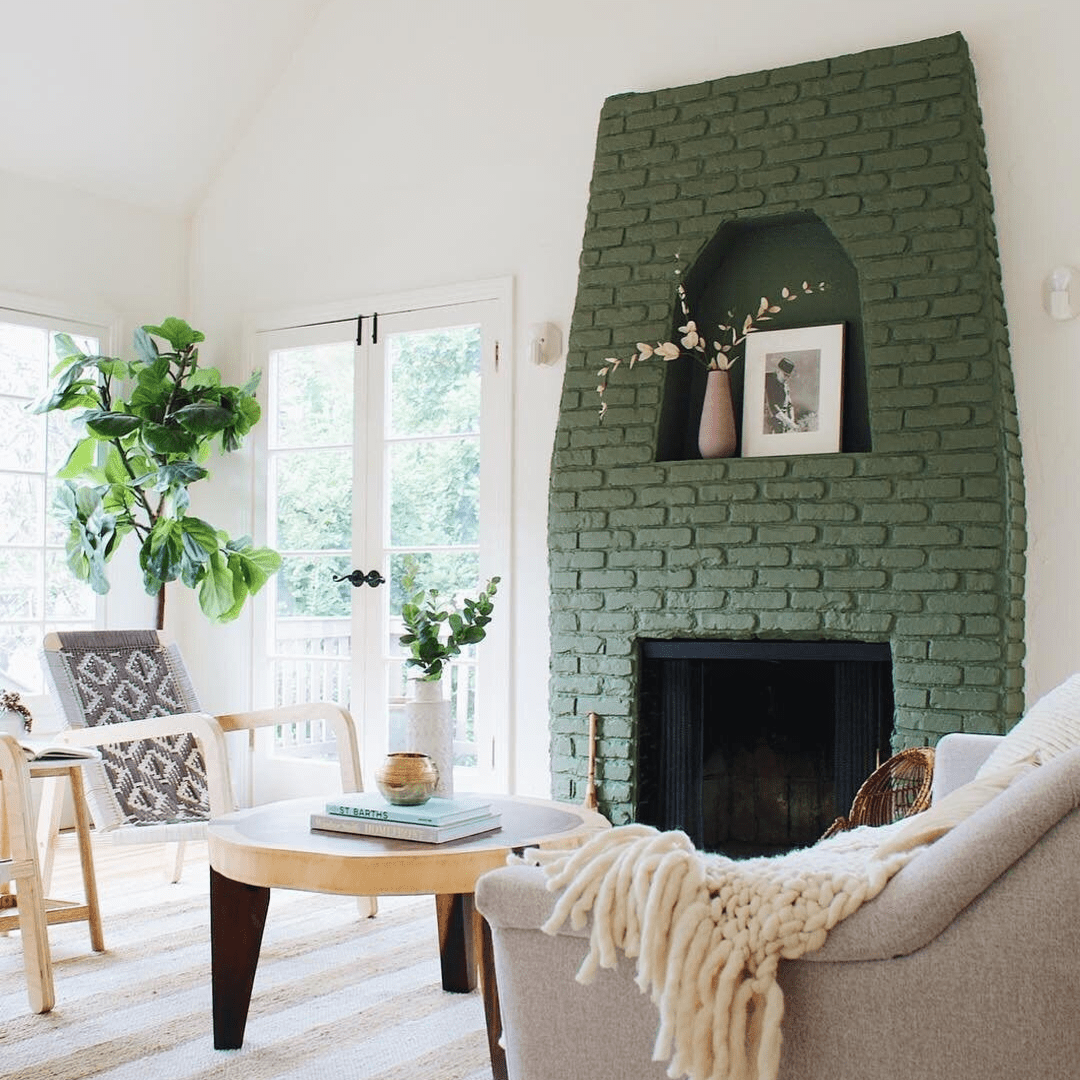 green painted brick in bright living room