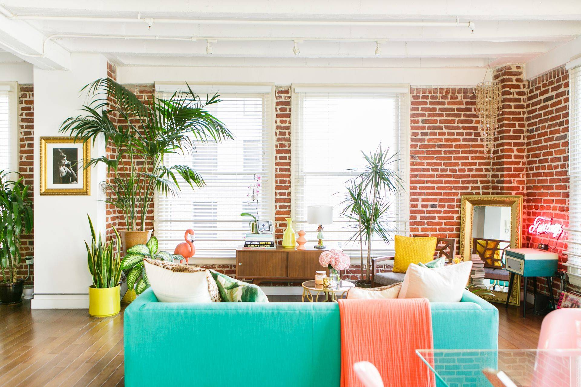 Tiffany Blue Turquoise Teal Aqua Couch Bright Open Living Room Red Brick Interior Wall Areca Palm Tree Indoor Decor