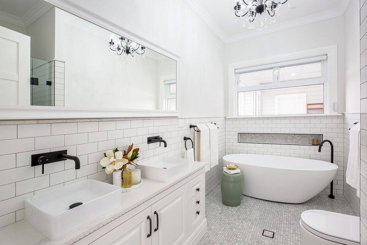 Adding small accents to the all-white bathroom can make a big visual impact