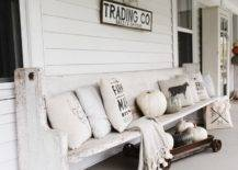 Antique Wooden Bench with Earth Toned Pillows