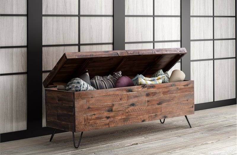 Assorted cushions inside wood storage bench