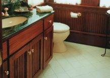 Bathroom sink in dark green and brown cabinetry