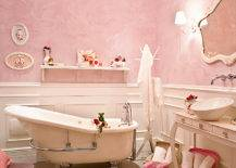 Bathroom with pink walls and white fixtures