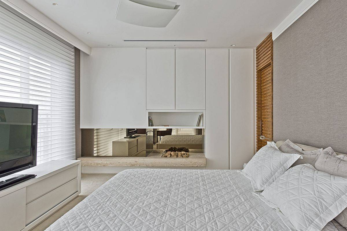 Bedroom-of-the-apartment-in-white-and-light-brown-with-TV-and-entertainment-unit-17451