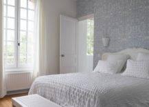 Bedroom with grey wallpaper and chandelier