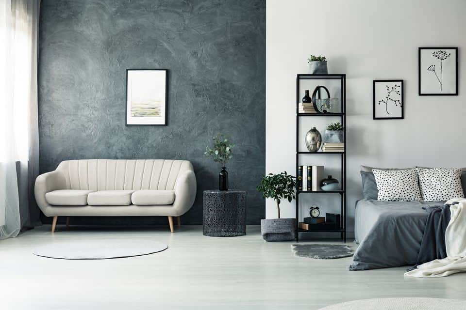 Bedroom with sofa on the corner