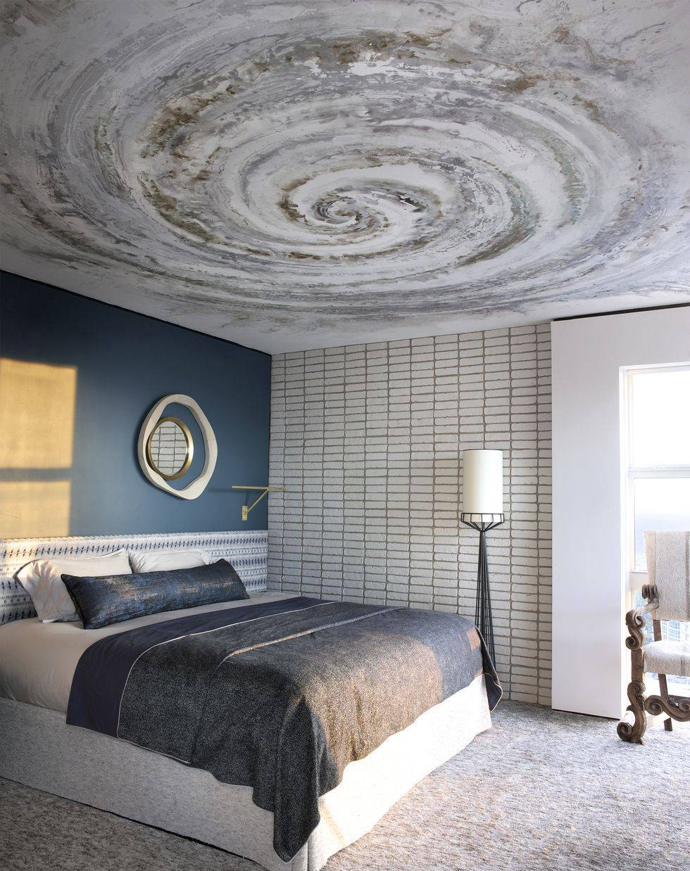 Bedroom with spiral painting on the ceiling