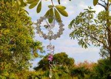 Bird wind spinner hanging from a tree branch