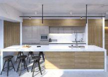 Black stools beside long kitchen island