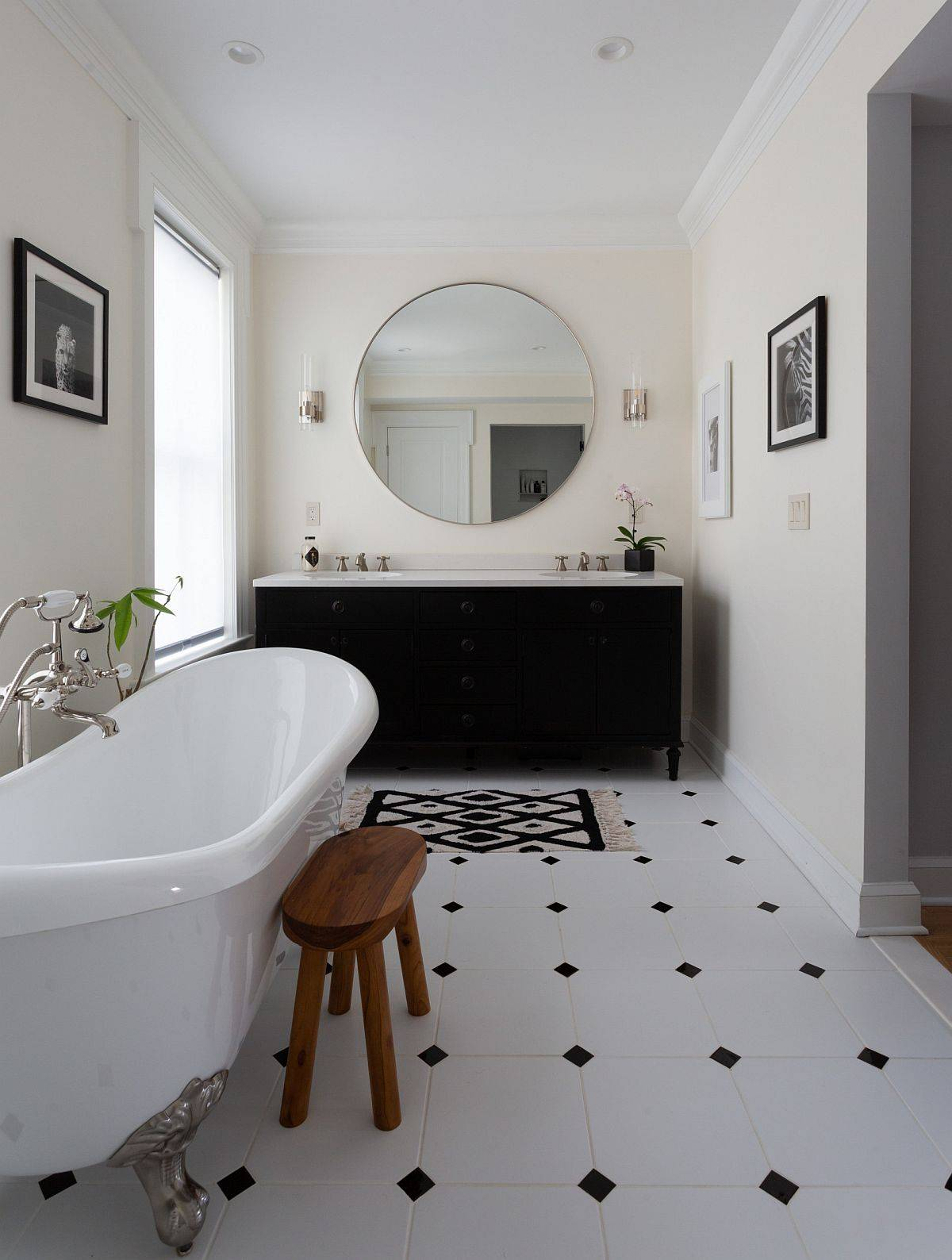 Black vanity along with cleverly placed black accents in the all-white bathroom makes a big impact