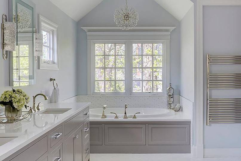 Blue and gray master bath color with round chandelier