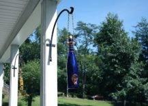 Bottles hanging from house pillars