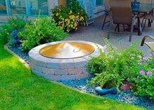 Brick fire pit in between flower beds