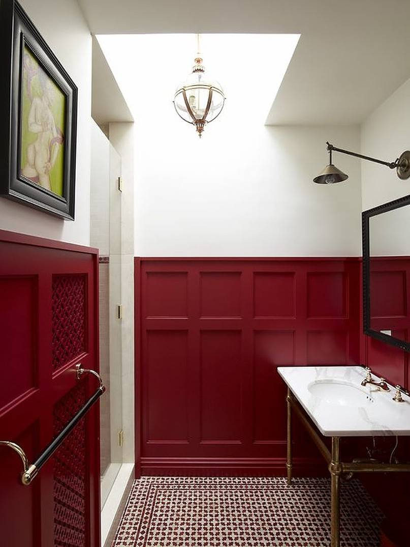 Burgundy wainscoting bathroom wall with marble sink
