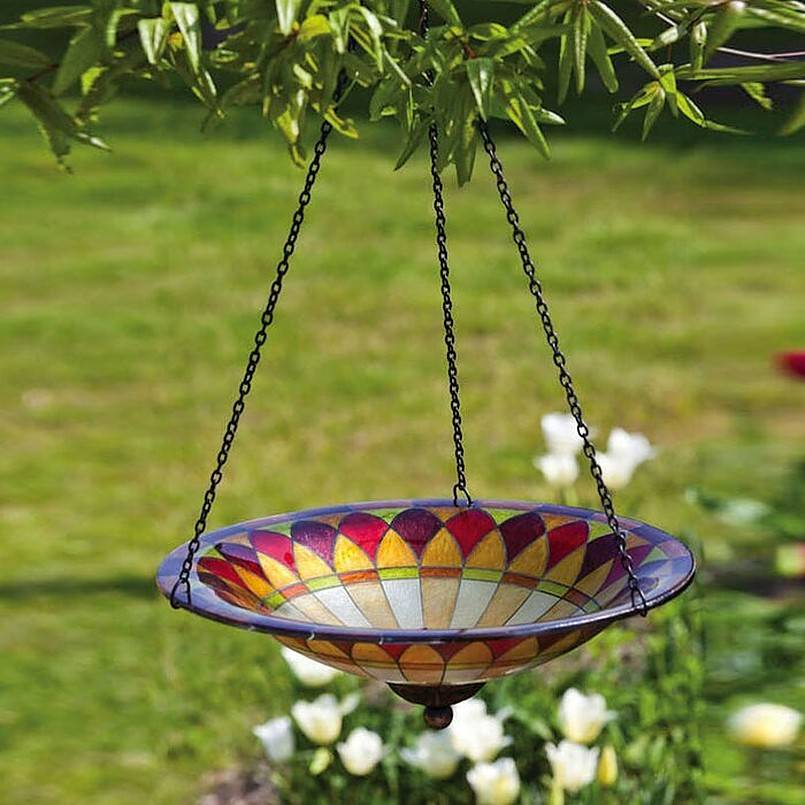 Colorful bird bath hanging from a tree