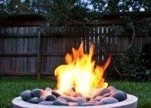 Concrete fire pit with burning fire