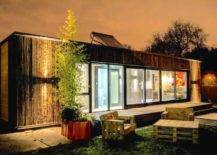 Container house with glass panels