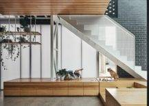 Custom-wooden-platform-under-the-staircase-with-wooden-storage-built-in-boxes-98698-217x155