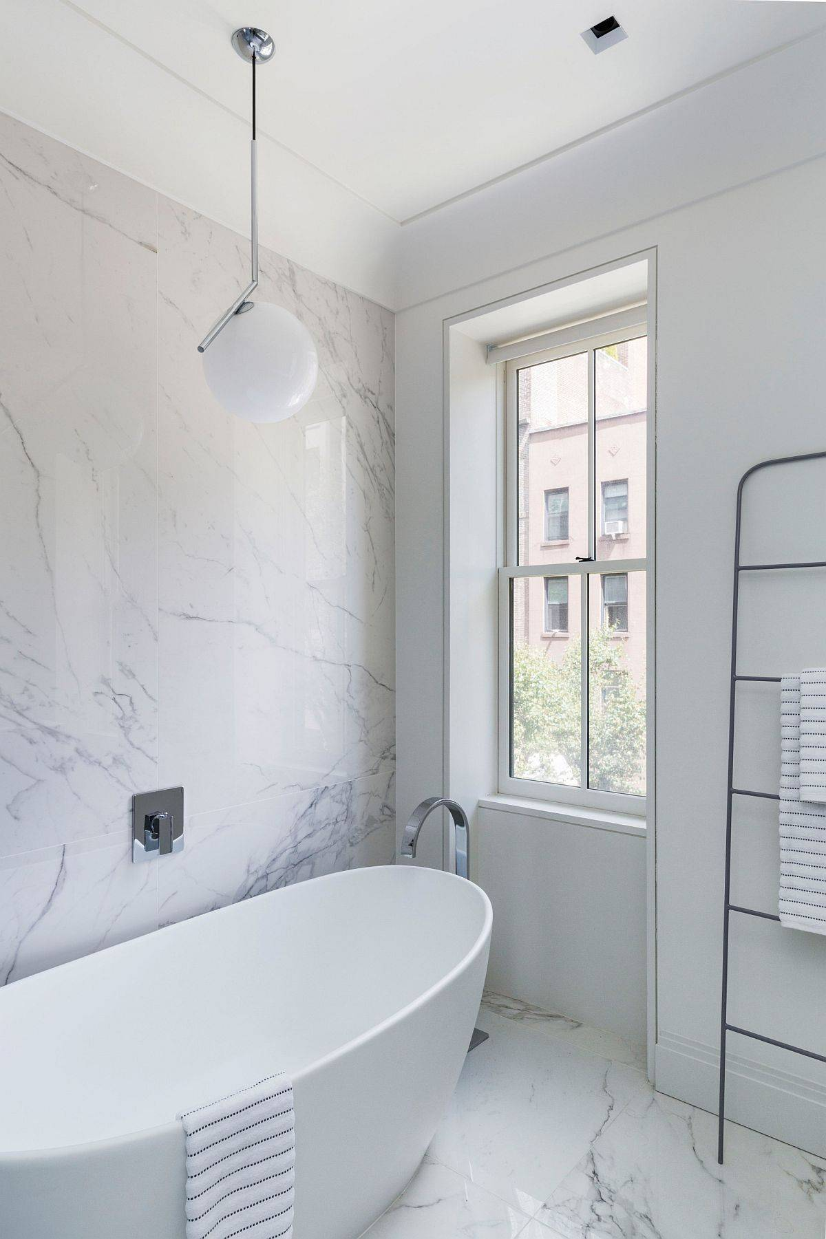 Dashing white tile for the modern bathroom in white with ample natural light