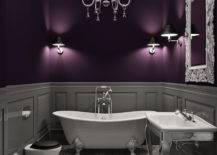 Elegant bathroom with chandelier and purple wall with grey wainscoting