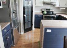 Empty kitchen counter with blue cupboards