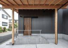 Entrance-of-the-home-in-black-with-wooden-door-and-simple-accents-67667-217x155