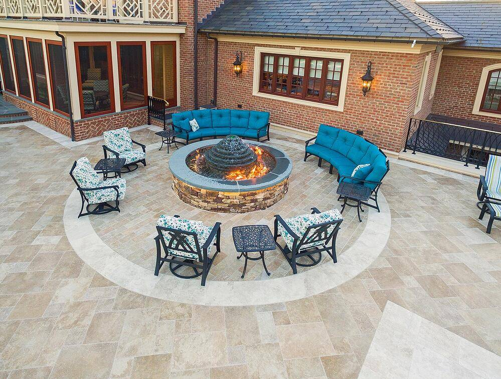 Fire pit surrounded by blue chairs and sofas