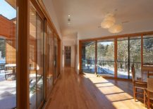 Glass-walls-and-sliding-glass-doors-connect-the-interior-with-the-rocky-landscape-outside-63717-217x155