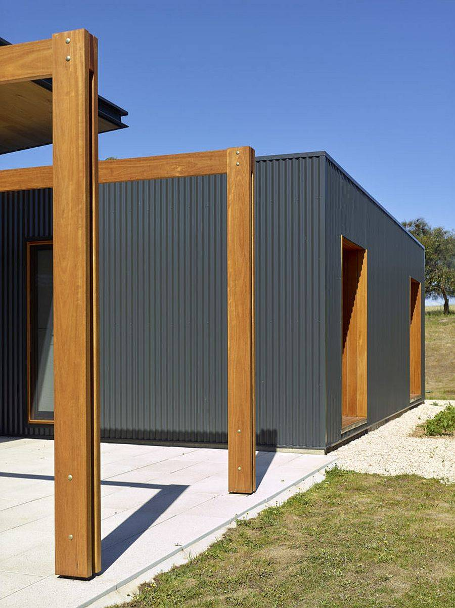 Gray corrugated steel, timber and recycled brick bring green goodness to this home