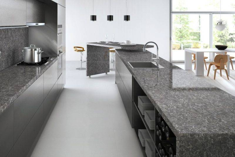 Gray kitchen interior with wooden chairs and white table