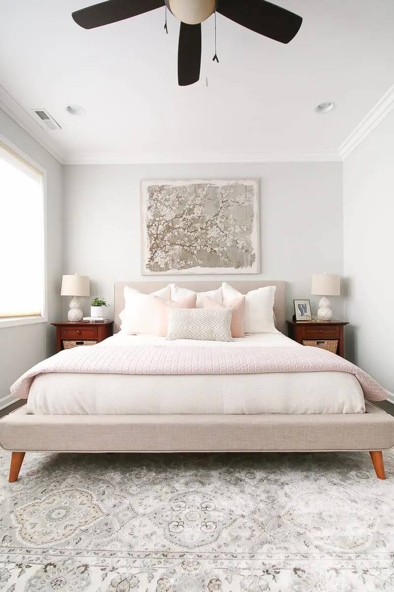 Grey painting above bed headboard