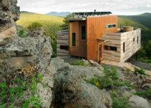 Hanging container house with green mountain view