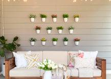 Hanging white pots with flowers