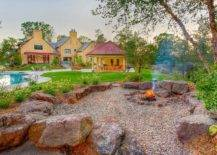 House exterior with pool and fire pit