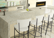 Kitchen with marble countertop and four white high chair