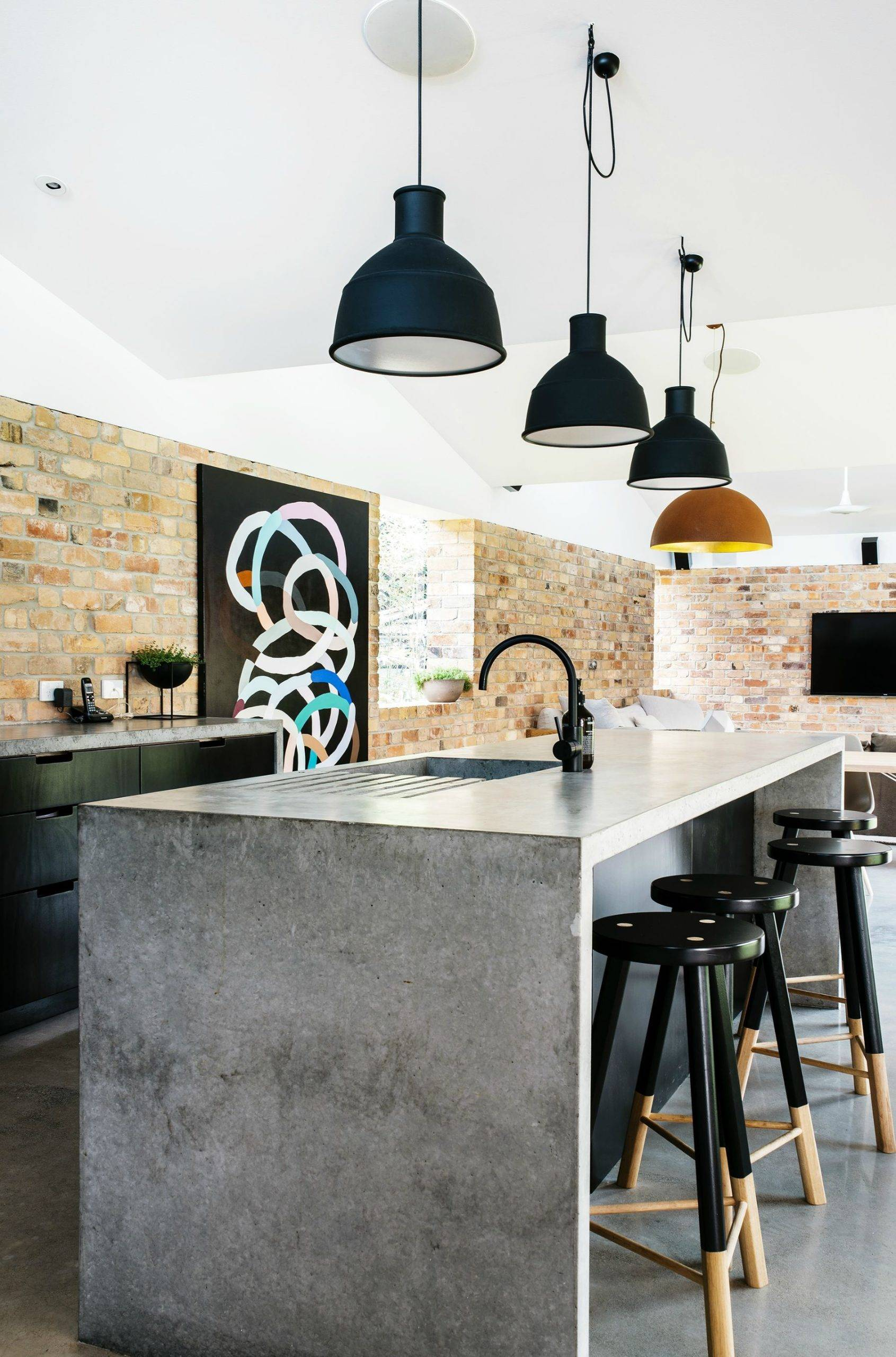 Large lamps over kitchen counter with sink