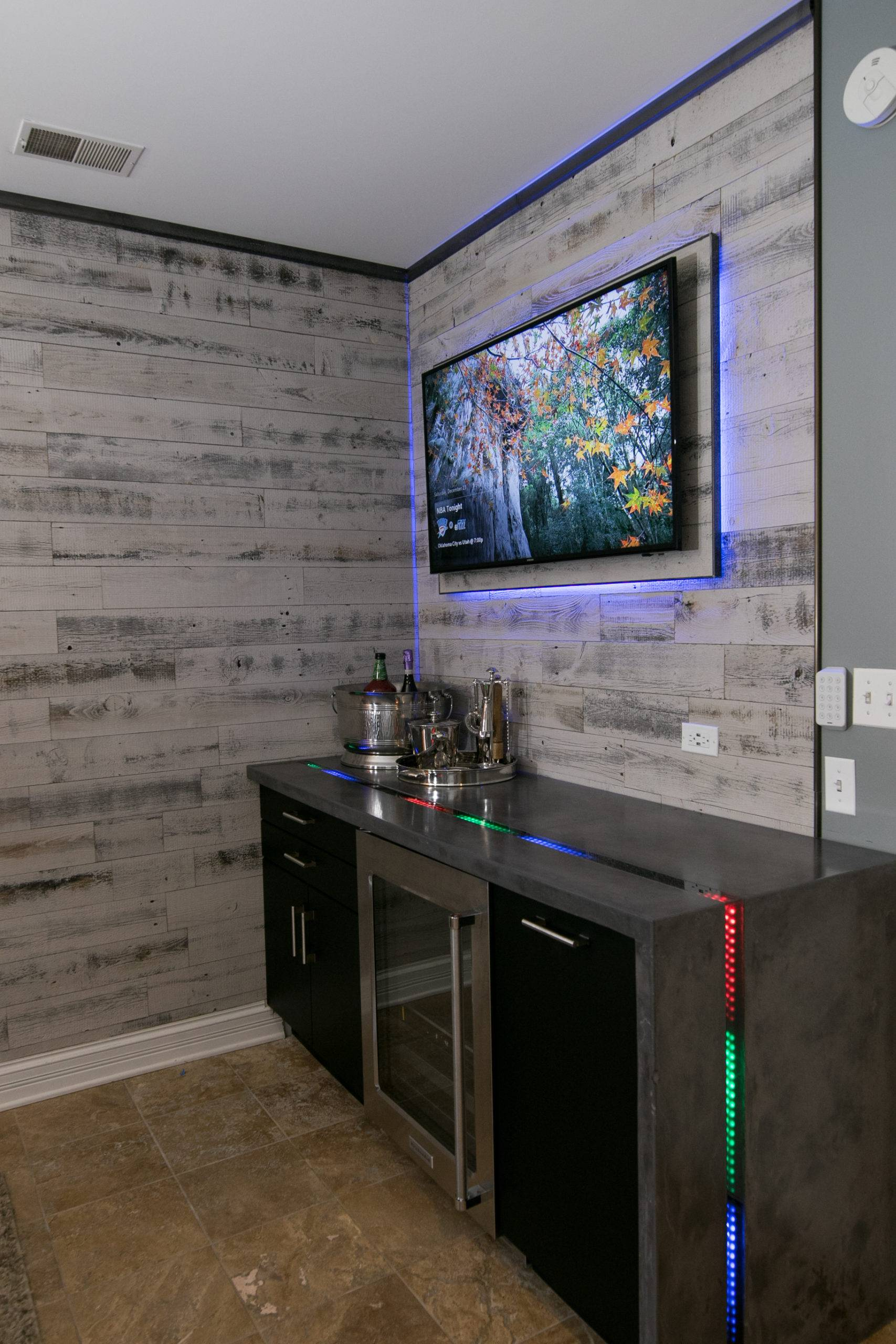 Large screen on wall and counter top with lights