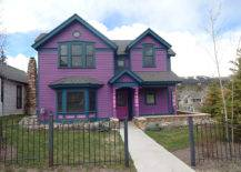 Lavender house facade with steel fence