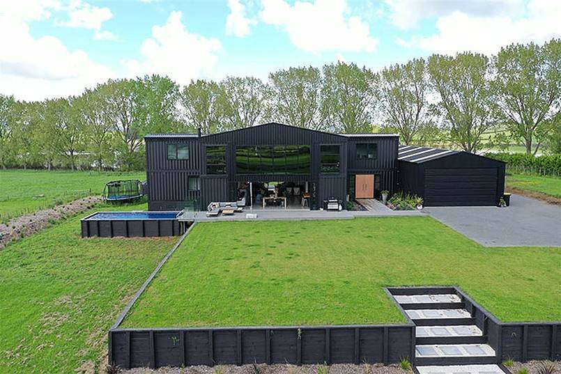Luxury container home with pool and wide lawn