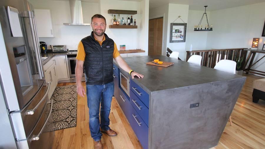 Man standing beside kitchen counter